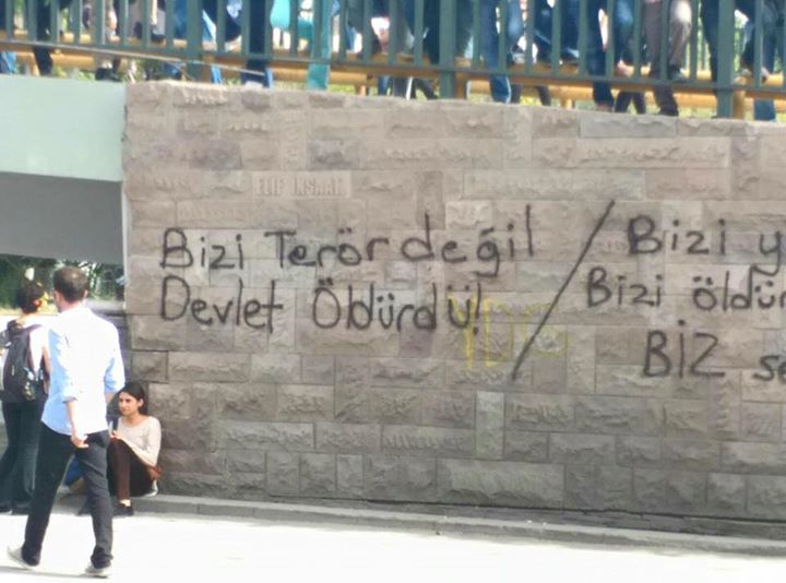 "Graffiti  at the site of the bomb explosion in Ankara that reads ""It was not terror that killed us, it was the state"""